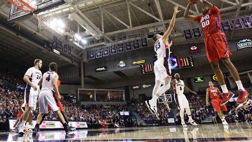 SMU's Ben Moore (00) takes a jump shot against Gonzaga's Kyle Wiltjer (33) during the first half of an NCAA college basketball game in Spokane, Wash., Monday, Nov. 17, 2014. (AP Photo/Young Kwak)