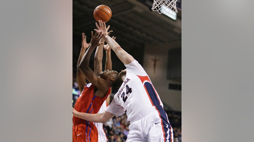 Gonzaga's Przemek Karnowski (24) and SMU's Yanick Moreira fight for a rebound during the first half of an NCAA college basketball game in Spokane, Wash., Monday, Nov. 17, 2014. (AP Photo/Young Kwak)