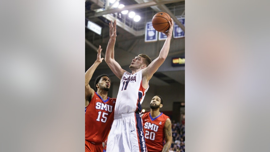 Gonzaga's Domantas Sabonis (11) takes a shot against SMU's Cannen Cunningham (15) during the first half of an NCAA college basketball game in Spokane, Wash., Monday, Nov. 17, 2014. (AP Photo/Young Kwak)