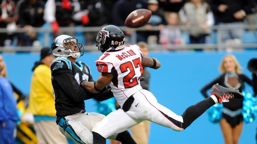 Carolina Panthers' Philly Brown, left, prepares to catch a touchdown pass against Atlanta Falcons' Robert McClain (27) in the second half of an NFL football game in Charlotte, N.C., Sunday, Nov. 16, 2014. (AP Photo/Mike McCarn)