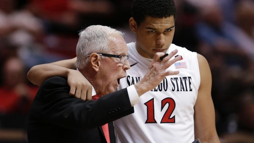 San Diego State coach Larry Fisher, left, has a word with guard Trey Kell during the first half in an NCAA college basketball game against Utah on Tuesday, Nov. 18, 2014, in San Diego. San Diego State won 53-49. (AP Photo/Gregory Bull)