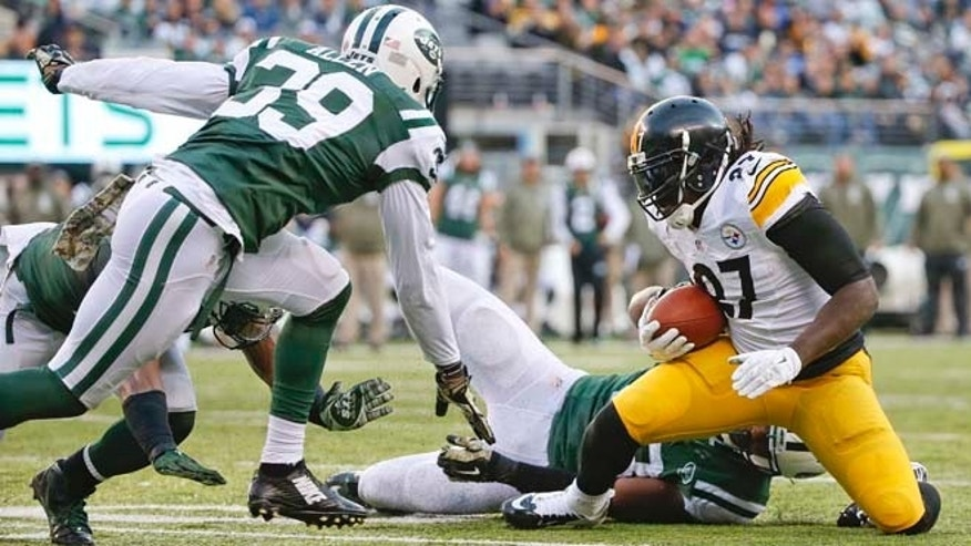 Nov. 9, 2014: Pittsburgh Steelers running back LeGarrette Blount (27) is tackled by New York Jets' Quinton Coples as Jets' Antonio Allen (39) closes in near the goal line during the second half of an NFL football game in East Rutherford, N.J. (AP)