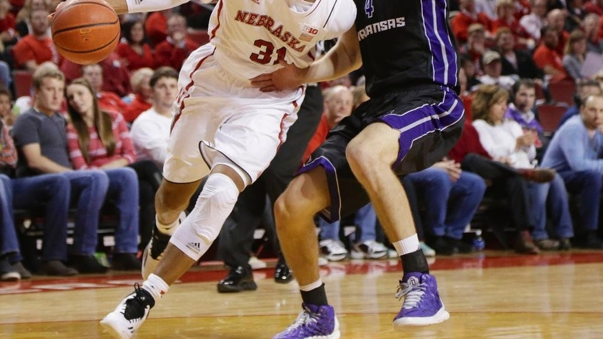 Nebraska guard Shavon Shields (31) drives past Central Arkansas center Albert Christensson (4) during the first half of an NCAA college basketball game in Lincoln, Neb., Tuesday, Nov. 18, 2014. (AP Photo/Nati Harnik)