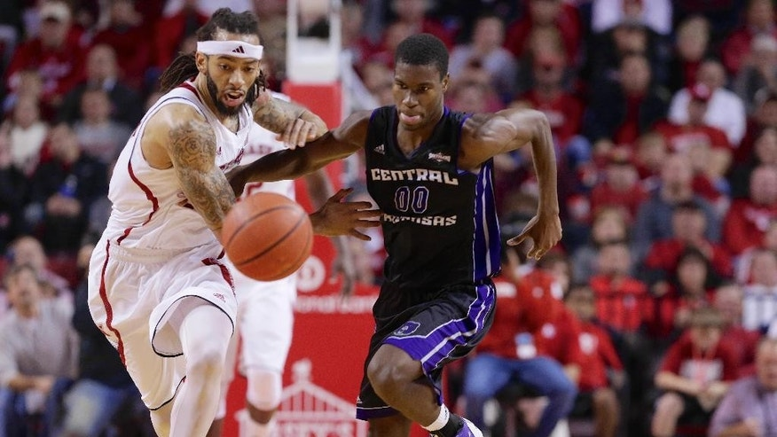 Nebraska forward Terran Petteway (5) and Central Arkansas forward Boo Milligan (0) chase a loose ball during the first half of an NCAA college basketball game in Lincoln, Neb., Tuesday, Nov. 18, 2014. (AP Photo/Nati Harnik)