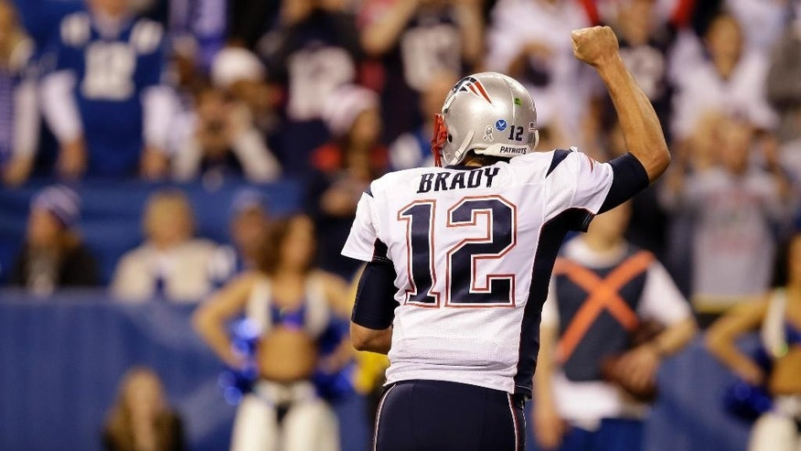 New England Patriots quarterback Tom Brady celebrates a touchdown by running back Jonas Gray during the second half of an NFL football game against the Indianapolis Colts in Indianapolis, Sunday, Nov. 16, 2014. (AP Photo/Darron Cummings)