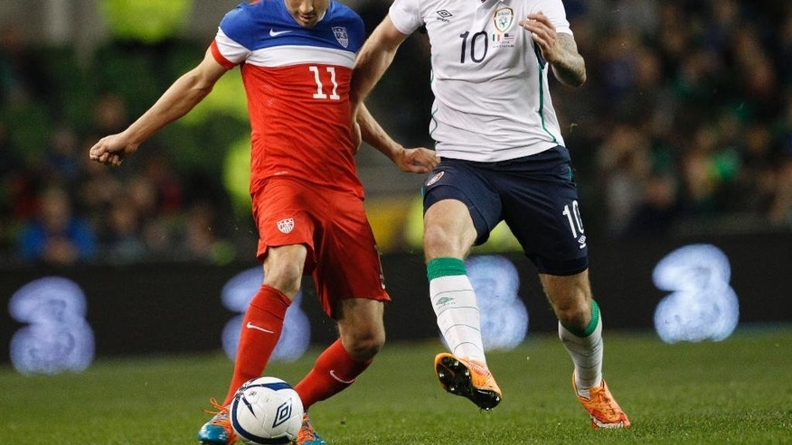 United States' Alejandro Bedoya, left,  and Republic of Ireland's Daryl Murphy vie for the ball,  during the international friendly soccer match at the Aviva stadium, Dublin, Ireland, Tuesday, Nov. 18, 2014. (AP Photo/Peter Morrison)