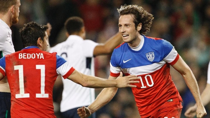 United States' Mix Diskerud, right, and Alejandro Bedoya celebrate after scoring a goal against Republic of Ireland during the international friendly soccer match between the at the Aviva stadium, Dublin, Ireland, Tuesday, Nov. 18, 2014. (AP Photo/Peter Morrison)