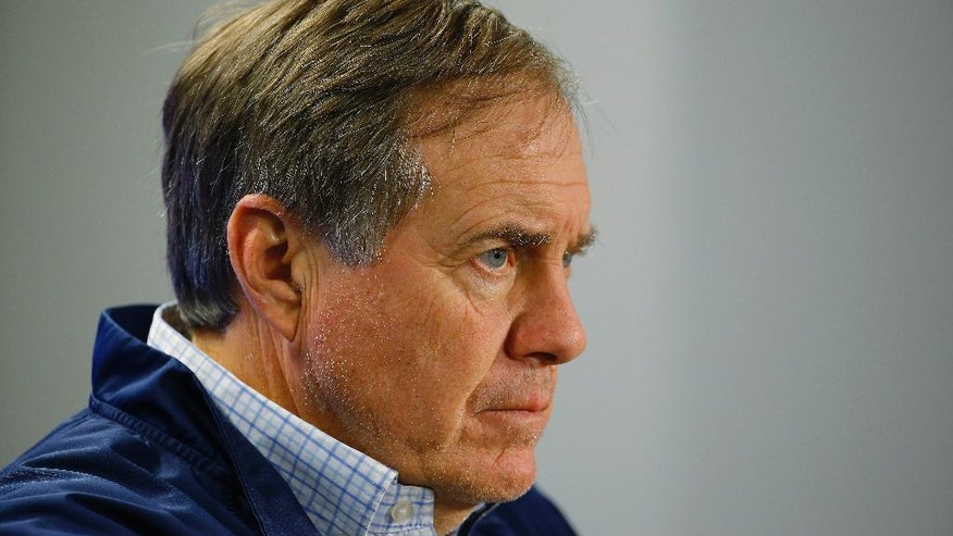 New England Patriots head coach Bill Belichick listens to a reporter's question during a media availability at the NFL football team's facility Wednesday, Nov. 19, 2014, in Foxborough, Mass. The Patriots will play the Detroit Lions on Sunday in Foxborough.(AP Photo/Stephan Savoia)