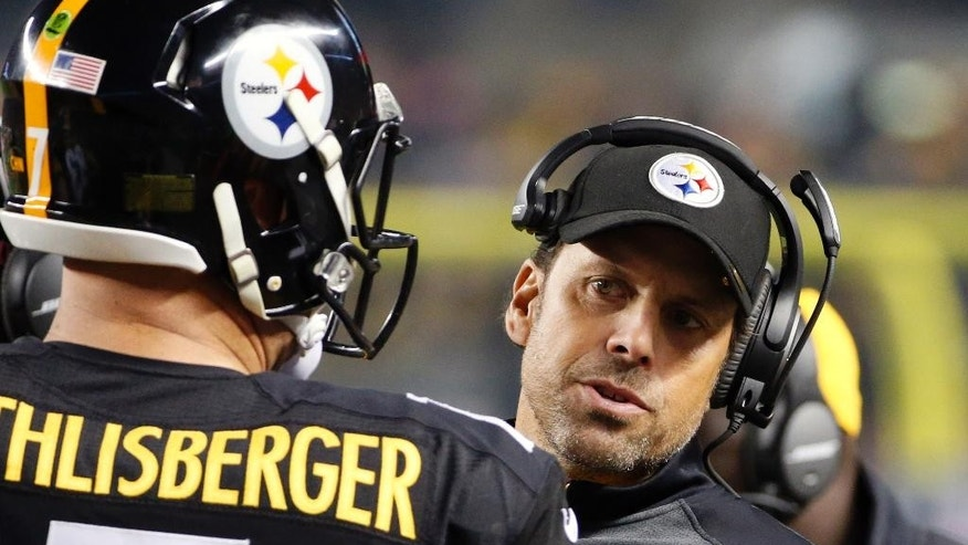 FILE - In this Oct. 20, 2014, file photo, Pittsburgh Steelers offensive coordinator Todd Haley, right, talks with quarterback Ben Roethlisberger on the sideline during an NFL football game against the Houston Oilers in Pittsburgh. Haley's space age offense went back to the basics on Monday night, Nov. 17, 2014, as the Steelers relied on Le'Veon Bell's churning legs and a dominant offensive line to escape Tennessee with a 27-24 win.  (AP Photo/Gene J. Puskar, File)