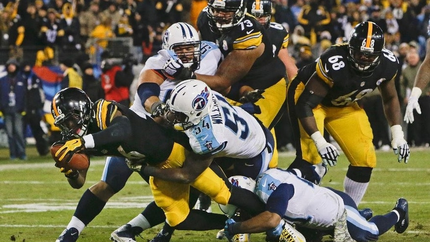 Pittsburgh Steelers running back Le'Veon Bell (26) scores a touchdown on a 5-yard run against the Tennessee Titans in the second half of an NFL football game Monday, Nov. 17, 2014, in Nashville, Tenn.(AP Photo/Wade Payne)