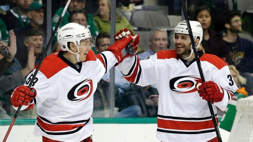 Carolina Hurricanes' Jeff Skinner (53) celebrates with Patrick Dwyer (39) after Skinner scored against the Dallas Stars in the second period of an NHL hockey game,  Tuesday, Nov. 18, 2014, in Dallas. (AP Photo/Tony Gutierrez)