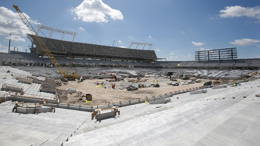 In this Monday, Aug. 18, 2014,  photo, construction of the Citrus Bowl stadium makes progress in Orlando, Fla. Almost 10 months of renovations have increased the nearly 80-year-old stadium to a capacity to more than 65,000, while adding 6,000 club seats, 33 luxury suites and 10,000 square-foot party deck. (AP Photo/John Raoux)