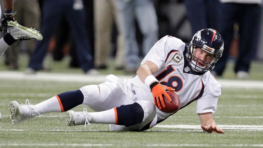 Denver Broncos quarterback Peyton Manning is slow to get up after being sacked for a 12-yard loss during the fourth quarter of an NFL football game against the St. Louis Rams Sunday, Nov. 16, 2014, in St. Louis. (AP Photo/Tom Gannam)