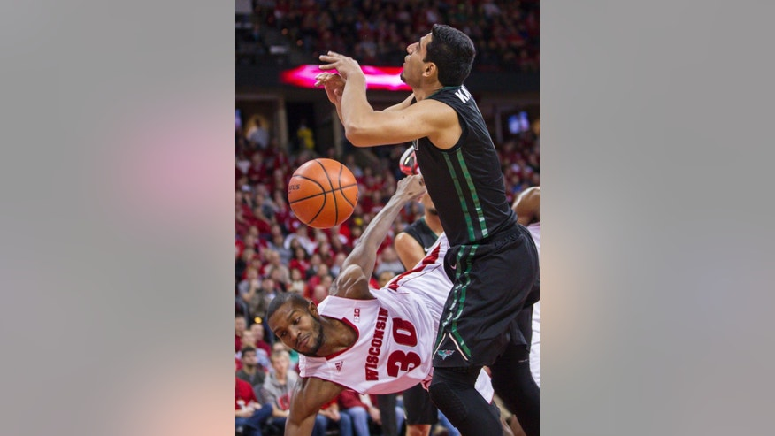 Wisconsin's Vitto Brown (30) fouls Green Bay's Kareem Kanter during the first half of an NCAA college basketball game Wednesday, Nov. 19, 2014, in Madison, Wis. (AP Photo/Andy Manis)