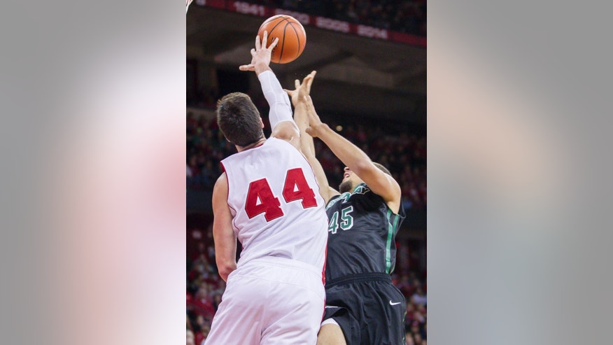 Wisconsin's Frank Kaminsky (44) blocks a shot by Green Bay's Kenneth Lowe during the first half of an NCAA college basketball game Wednesday, Nov. 19, 2014, in Madison, Wis. (AP Photo/Andy Manis)