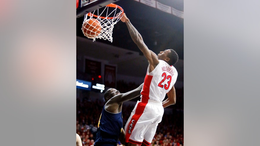 Arizona forward Rondae Hollis-Jefferson (23) shoots over UC Irvine center Mamadou Ndiaye (34) during the second half during an NCAA college basketball game, Wednesday, Nov. 19, 2014, in Tucson, Ariz. (AP Photo/Rick Scuteri)