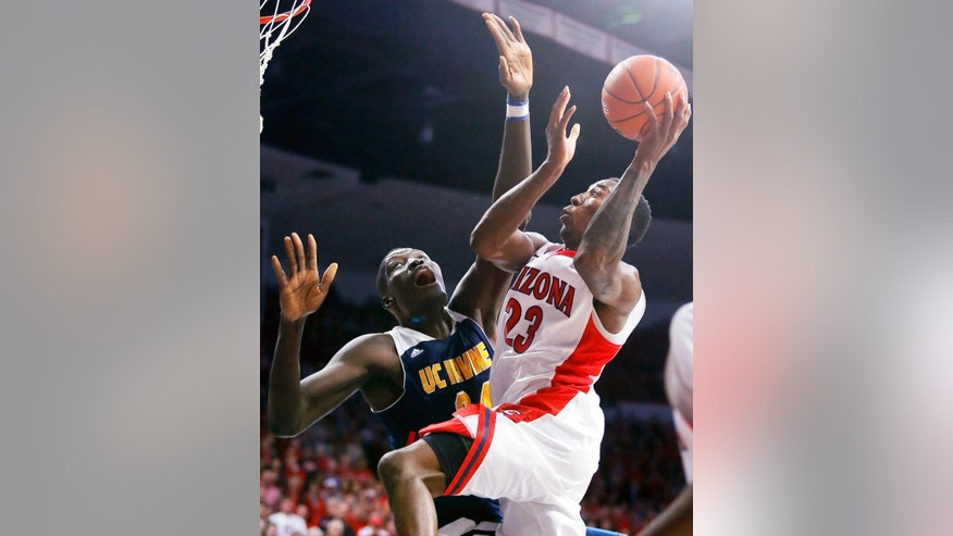 Arizona forward Rondae Hollis-Jefferson (23), right, drives on UC Irvine center Mamadou Ndiaye (34) during the second half during an NCAA college basketball game, Wednesday, Nov. 19, 2014, in Tucson, Ariz. (AP Photo/Rick Scuteri)