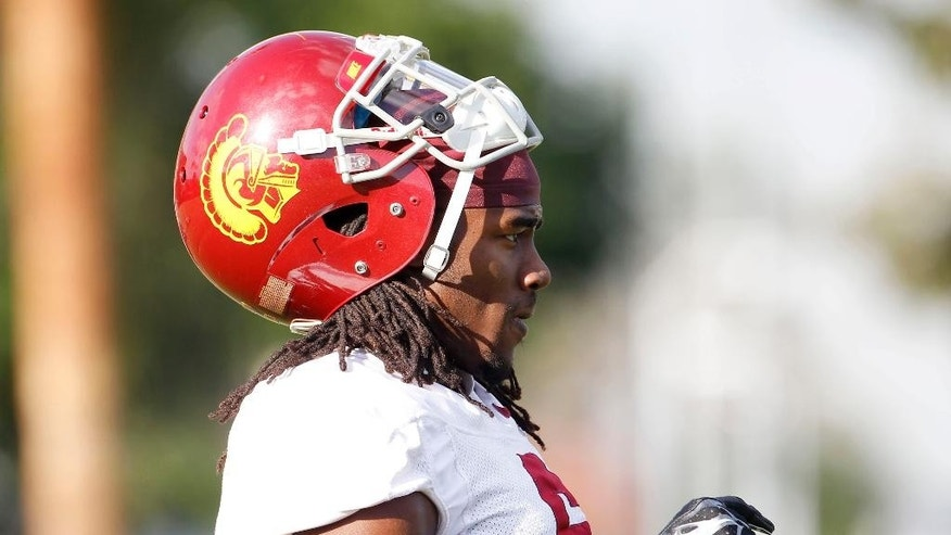 Southern California defensive back Josh Shaw (6) takes part in football team practice on the campus in Los Angeles Wednesday, Nov. 19, 2014. USC has reinstated Shaw, who had been suspended since he lied to school officials about how he sprained his ankles in a preseason fall. . (AP Photo/Nick Ut)