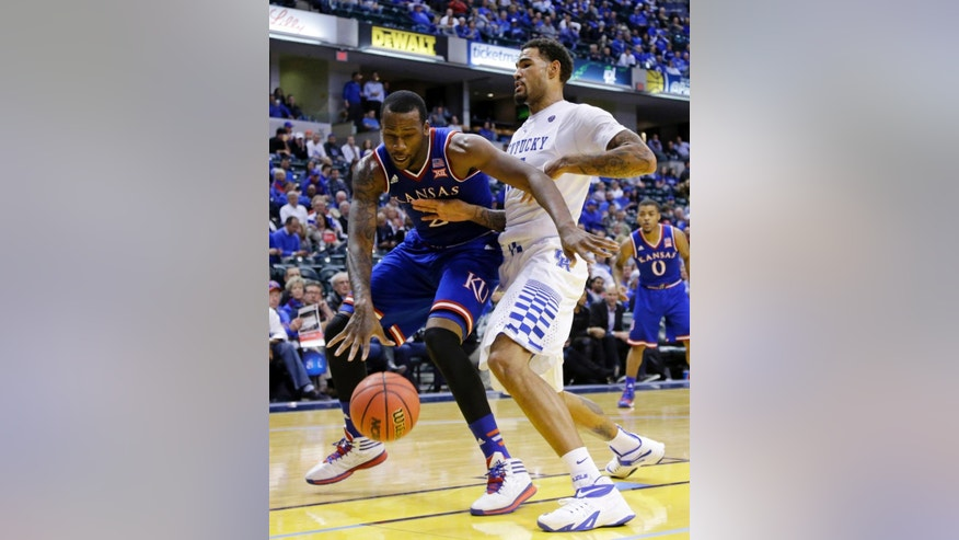 Kentucky's Willie Cauley-Stein, right, defends Kansas's Cliff Alexander in the second half of an NCAA college basketball game in Indianapolis, Tuesday, Nov. 18, 2014. Kentucky defeated Kansas 72-40. (AP Photo/Michael Conroy)
