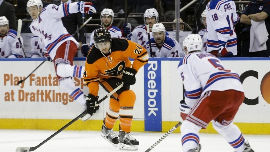 Philadelphia Flyers' Matt Read (24) shoots the puck past New York Rangers' Dan Girardi (5) during the first period of an NHL hockey game Wednesday, Nov. 19, 2014, in New York. (AP Photo/Frank Franklin II)