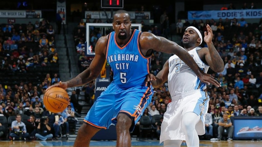 Oklahoma City Thunder center Kendrick Perkins, left, swats away the defensive efforts of Denver Nuggets guard Ty Lawson in the first quarter of an NBA basketball game in Denver, Wednesday, Nov. 19, 2014. (AP Photo/David Zalubowski)