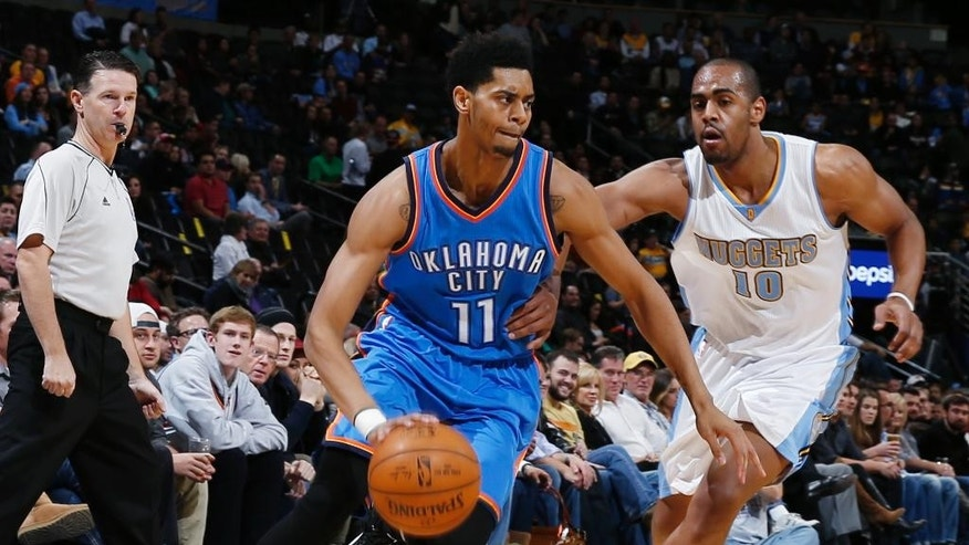 Oklahoma City Thunder guard Jeremy Lamb (11) drives past Denver Nuggets guard Arron Afflalo in the first quarter of an NBA basketball game in Denver, Wednesday, Nov. 19, 2014. (AP Photo/David Zalubowski)