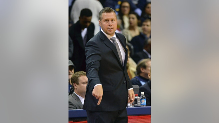 Memphis Grizzlies head coach David Joerger gestures in the second half of an NBA basketball game against the Houston Rockets, Monday, Nov. 17, 2014, in Memphis, Tenn. The Grizzlies won 119-93. (AP Photo/Brandon Dill)
