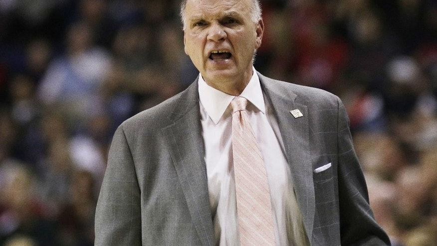 Saint Joseph'scoach Phil Martelli argues a call with an official during the first half of an NCAA college basketball game against Gonzaga in Spokane, Wash., Wednesday, Nov. 19, 2014. (AP Photo/Young Kwak)