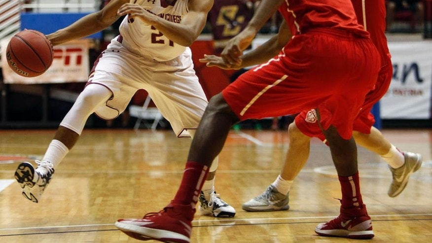Boston College guard Olivier Hanlan, left, dribbles against New Mexico guard Devon Williams during a NCAA college basketball game in San Juan, Puerto Rico, Thursday, Nov. 20, 2014. (AP Photo/Ricardo Arduengo)