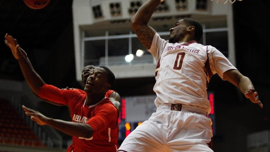 Boston College forward Garland Owens, right, battles for a rebound against New Mexico guard Sam Logwood during a NCAA college basketball game in San Juan, Puerto Rico, Thursday, Nov. 20, 2014. (AP Photo/Ricardo Arduengo)