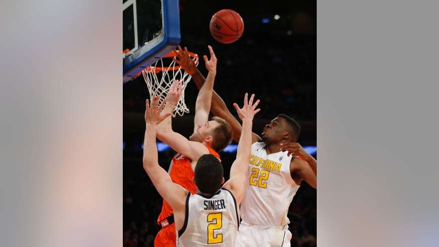 California guard Sam Singer (2) and center Kingsley Okoroh (22) defend as Syracuse guard Trevor Cooney (10) goes up for a layup in the first half of an NCAA basketball game at Madison Square Garden in New York, Thursday, Nov. 20, 2014.  (AP Photo/Kathy Willens)