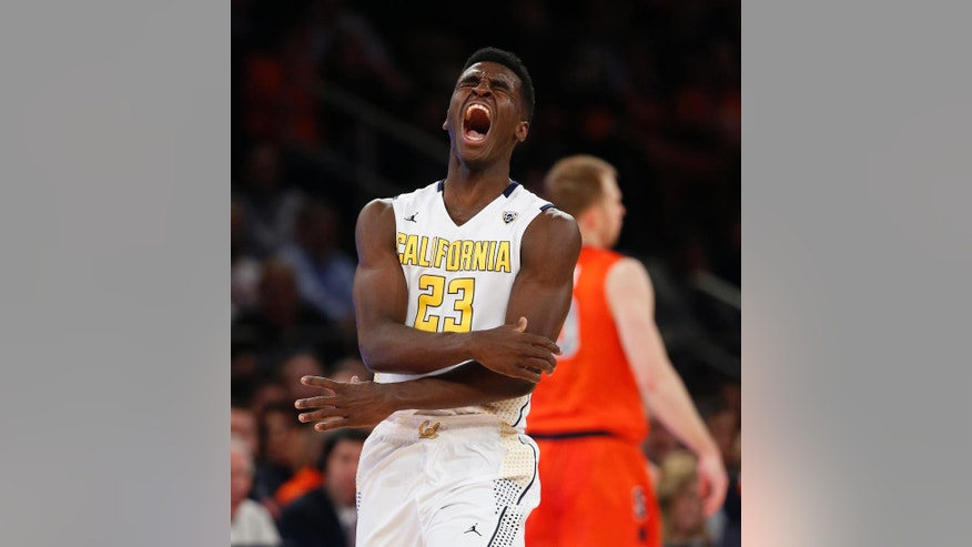 California guard Jabari Bird (23) reacts after hitting a three-point shot against Syracuse in the first half of an NCAA basketball game at Madison Square Garden in New York, Thursday, Nov. 20, 2014.  (AP Photo/Kathy Willens)