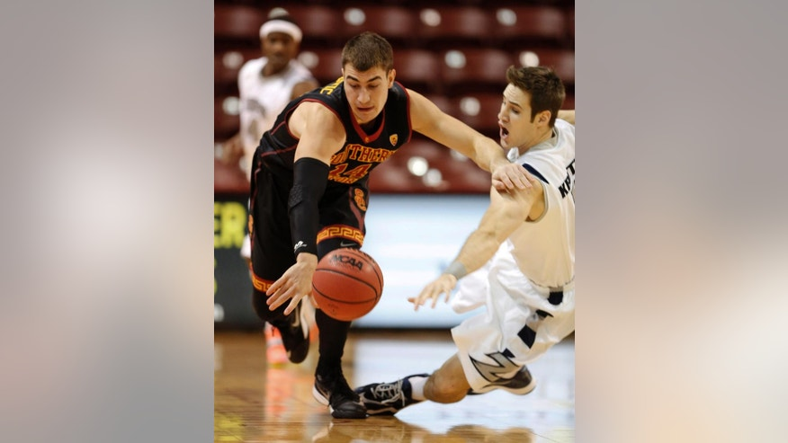 Southern California's Strahinja Gavrilovic, left, of Serbia, fights for the ball with Akron's Jake Kretzer in the first half at the Charleston Classic NCAA college basketball tournament in Charleston, S.C.,Thursday, Nov. 20, 2014. (AP Photo/Mic Smith)