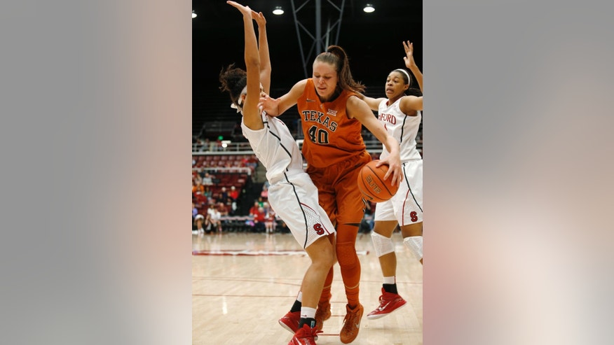Texas center Kelsey Lang gets sandwiched between Stanford forward Kaylee Johnson, left, and forward Eric Mall during the first half of an NCAA college basketball game in Stanford, Calif., Thursday, Nov. 20, 2014. (AP Photo/Beck Diefenbach)