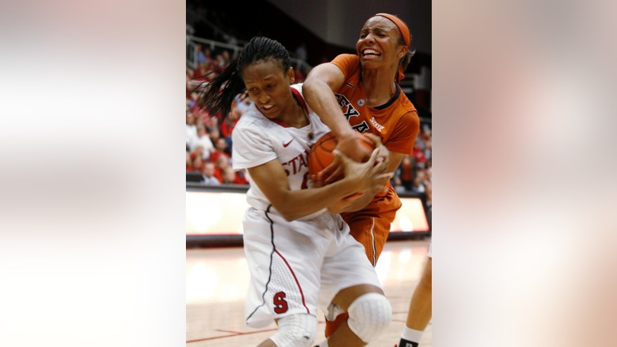 Stanford guard Alex Green, left, and Texas guard Brianna Taylor wrestle for the ball during the first half of an NCAA college basketball game in Stanford, Calif., Thursday, Nov. 20, 2014. (AP Photo/Beck Diefenbach)
