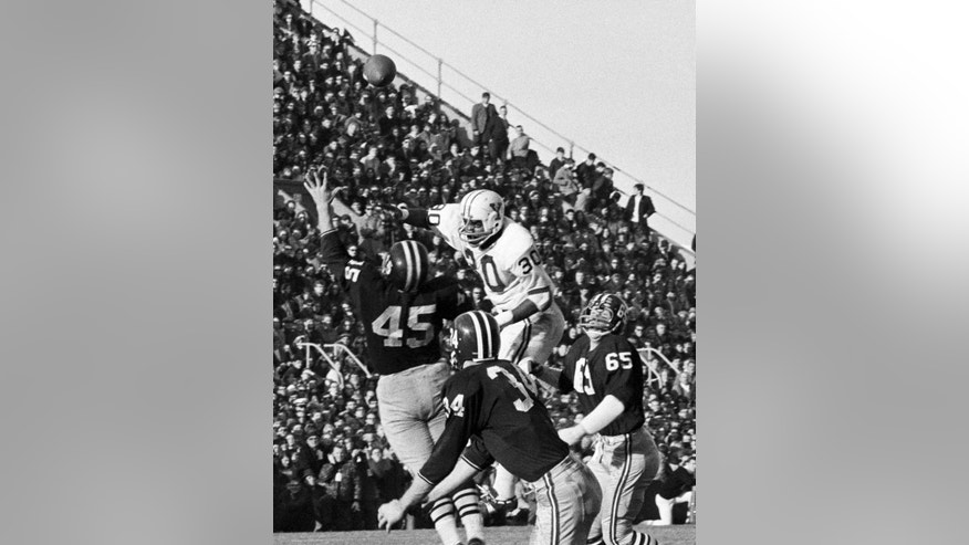 FILE - In this Nov. 23, 1968, file photo, Harvard's Pat Conway (34) attempts to intercept a pass from Yale quarterback Brian Dowling intended for Cal Hill, not shown, as the ball sails over Harvard's Tom Wynne (45) in the second period of their annual college rivalry football game at Harvard Stadium in Cambridge, Mass. Harvard has gotten used to beating Yale in The Game, eight straight victories. But there's something nice about both teams being at their best for one of college football's oldest rivalries. (AP Photo/File)