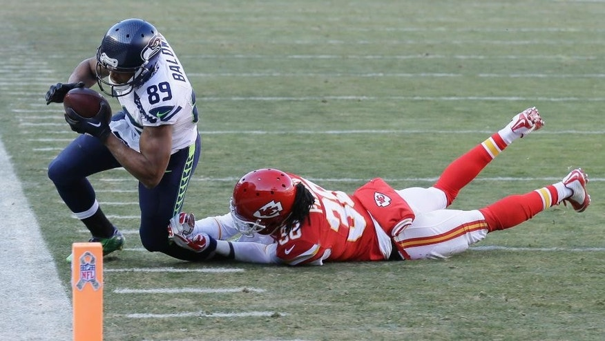 Kansas City Chiefs strong safety Ron Parker (38) tackles Seattle Seahawks wide receiver Doug Baldwin (89) in the second half of an NFL football game in Kansas City, Mo., Sunday, Nov. 16, 2014. (AP Photo/Charlie Neibergall)