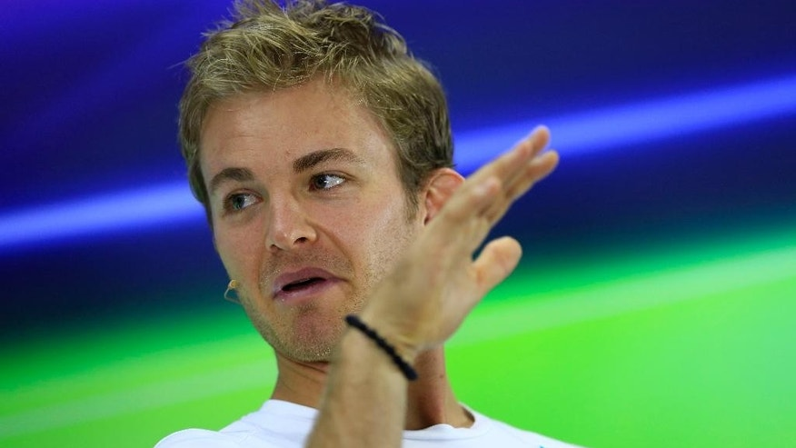 Mercedes driver Nico Rosberg of Germany attends a news conference at the Yas Marina racetrack in Abu Dhabi, United Arab Emirates, Thursday, Nov. 20, 2014. With double points on offer in the Formula One finale, there could yet be a bitter twist to the fascinating title duel between Mercedes teammates Lewis Hamilton and Nico Rosberg at the Abu Dhabi Grand Prix. The Emirates Formula One Grand Prix will take place on Sunday. (AP Photo/Hassan Ammar)