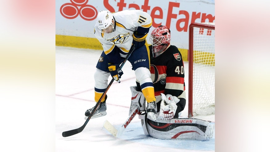 Ottawa Senators' Robin Lehner makes a save as he is screened by Nashville Predators' Taylor Beck during third NHL hockey action in Ottawa on Thursday, Nov. 20, 2014. The Sens defeated the Predators 3-2. (AP Photo/The Canadian Press, Sean Kilpatrick)