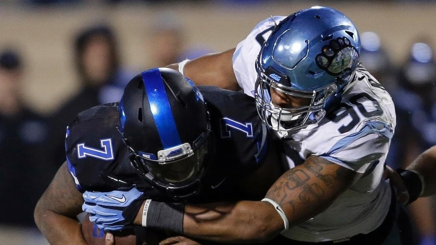 Duke quarterback Anthony Boone (7) is tackled by North Carolina's Nazair Jones (90) during the second half of an NCAA college football game in Durham, N.C., Thursday, Nov. 20, 2014. North Carolina won 45-20. (AP Photo/Gerry Broome)