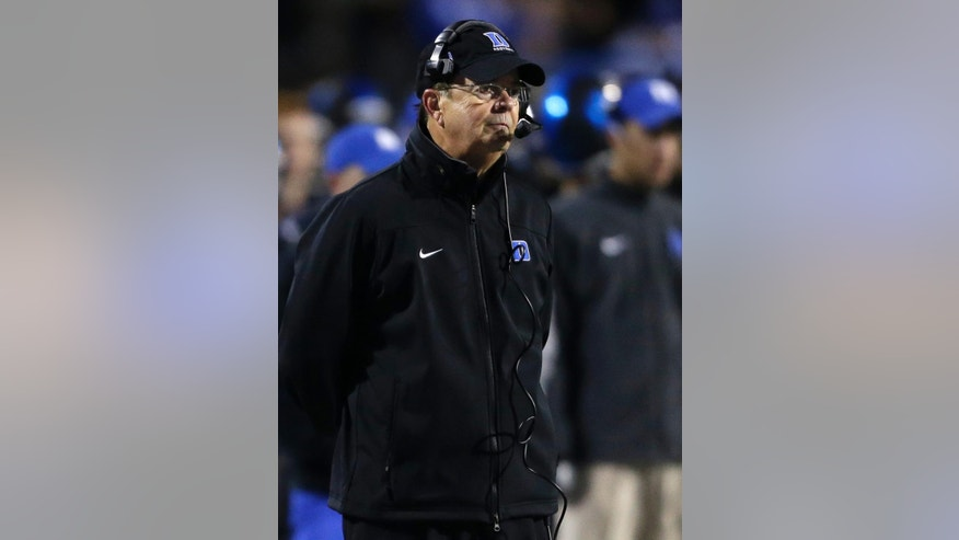 Duke coach David Cutcliffe watches form the sideline during the first half of an NCAA college football game against North Carolina in Durham, N.C., Thursday, Nov. 20, 2014. North Carolina won 45-20. (AP Photo/Gerry Broome)