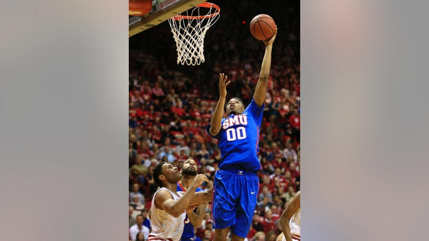 SMU's Ben Moore puts up a shot against Indiana's James Blackmon Jr. (1) during the first half of an NCAA college basketball game Thursday, Nov. 20, 2014, in Bloomington, Ind. (AP Photo/Darron Cummings)