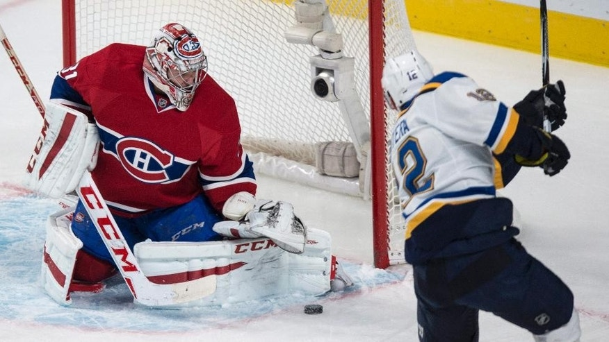 Montreal Canadiens goalie Carey Price, left, makes a save against St. Louis Blues' Jori Lehtera during third-period NHL hockey game action Thursday, Nov. 20, 2014, in Montreal. The Canadiens won 4-1. (AP Photo/The Canadian Press, Paul Chiasson)