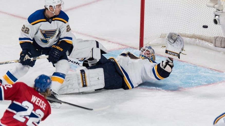 Montreal Canadiens' Dale Weise (22) scores past St. Louis Blues goalie Jake Allen as defenceman Kevin Shattenkirk looks on during second-period NHL hockey game action Thursday, Nov. 20, 2014, in Montreal. (AP Photo/The Canadian Press, Paul Chiasson)