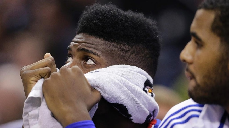 Philadelphia 76ers' Nerlens Noel holds a towel over his face during the second half of an NBA basketball game against the San Antonio Spurs, Monday, Nov. 17, 2014, in San Antonio.  San Antonio won 100-75. (AP Photo/Eric Gay)