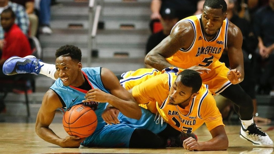 San Diego State guard Dakarai Allen beats Cal State Bakersfield center Abdul Ahmed and guard Dashawn Richmond, top, to a loose ball during the first half of an NCAA college basketball game Thursday, Nov. 20, 2014, in San Diego. (AP Photo/Lenny Ignelzi