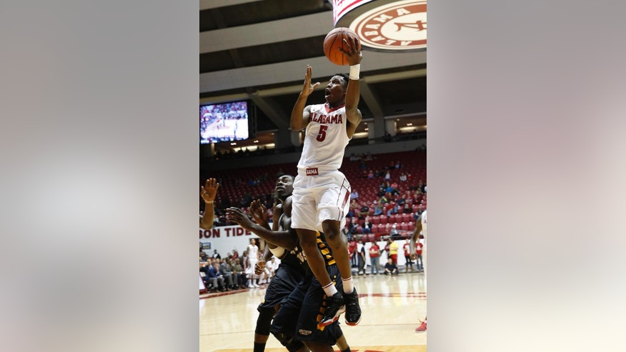 Alabama's Justin Coleman (5) drives to the basket against Southern Mississippi during the first half of an NCAA college basketball game at Coleman Coliseum in Tuscaloosa, Ala., on Thursday, Nov. 20, 2014. (AP Photo/Tuscaloosa News, Robert Sutton)