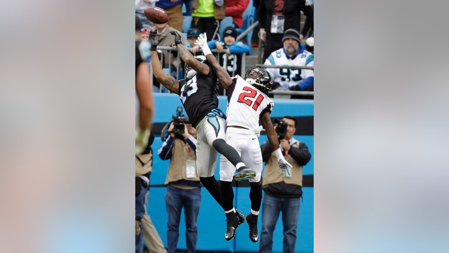 Carolina Panthers' Kelvin Benjamin (13) catches a touchdown pass against Atlanta Falcons' Desmond Trufant (21) in the second half of an NFL football game in Charlotte, N.C., Sunday, Nov. 16, 2014. (AP Photo/Bob Leverone)