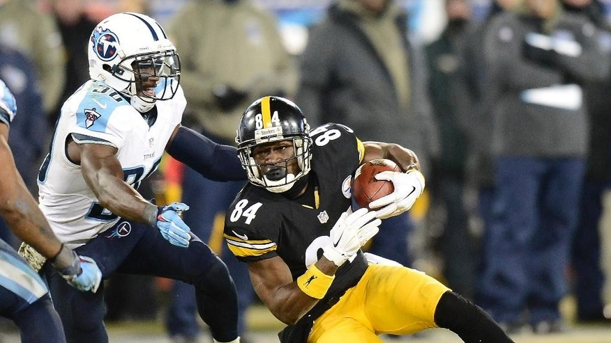 Pittsburgh Steelers wide receiver Antonio Brown (84) tries to get past Tennessee Titans cornerback Jason McCourty (30) in the second half of an NFL football game Monday, Nov. 17, 2014, in Nashville, Tenn. (AP Photo/Mark Zaleski)