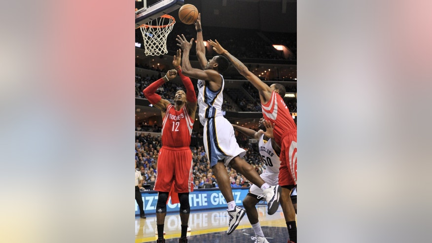 Memphis Grizzlies guard Tony Allen, second from left, shoots over Houston Rockets center Dwight Howard (12) while Memphis Grizzlies forward Zach Randolph (50) blocks out Houston Rockets forward Trevor Ariza, right, in the second half of an NBA basketball game Monday, Nov. 17, 2014, in Memphis, Tenn. The Grizzlies won 119-93. (AP Photo/Brandon Dill)